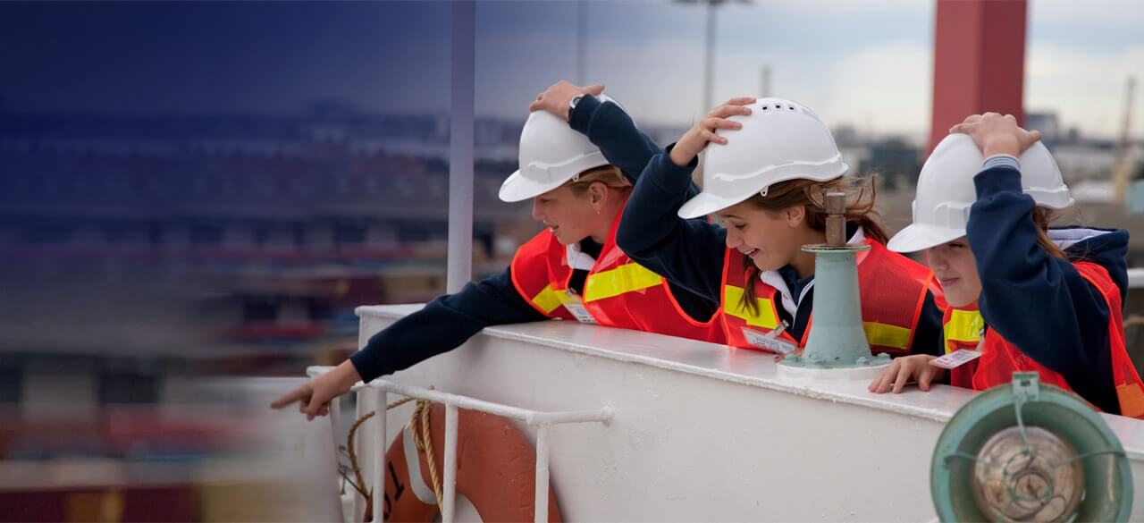 excited students in high vis vests pointing at the port of melbourne operations